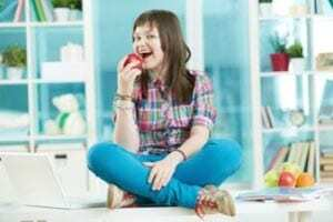 youngster eating apple